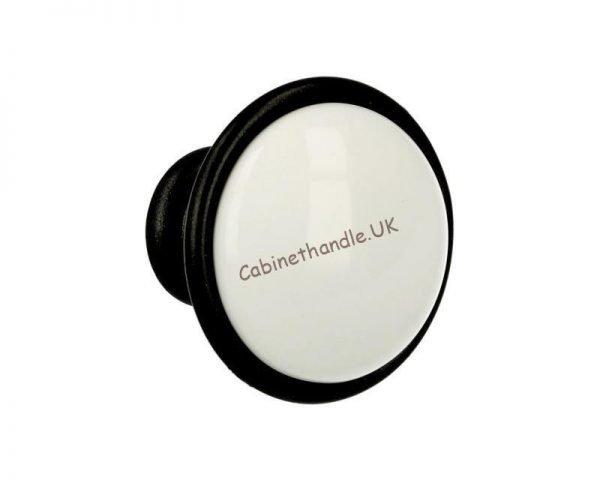 white ceramic knob on graphite base