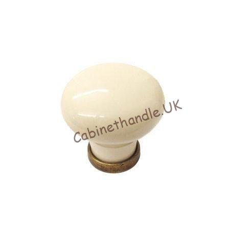 antique-brass-and-cream ceramic drawer knob