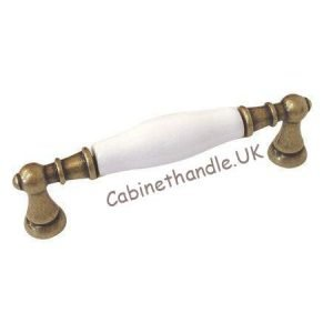 old brass and white ceramic kitchen handle