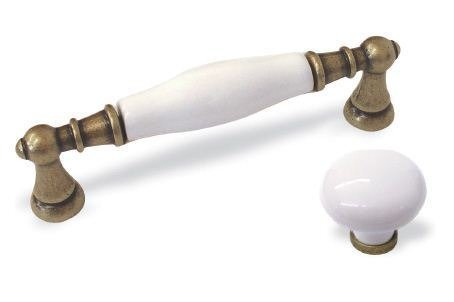 white ceramic and brass kitchen cupboard handle and konb