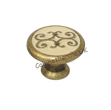 old brass and cream enamel kitchen knob