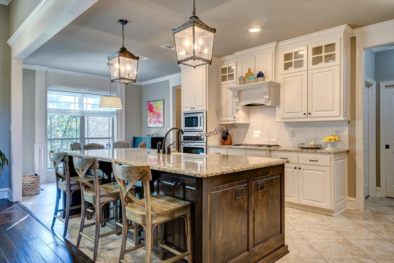 white kitchen with black cabinet handles