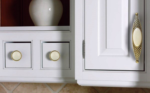 gold ceramic cupboard handles on white cabinets