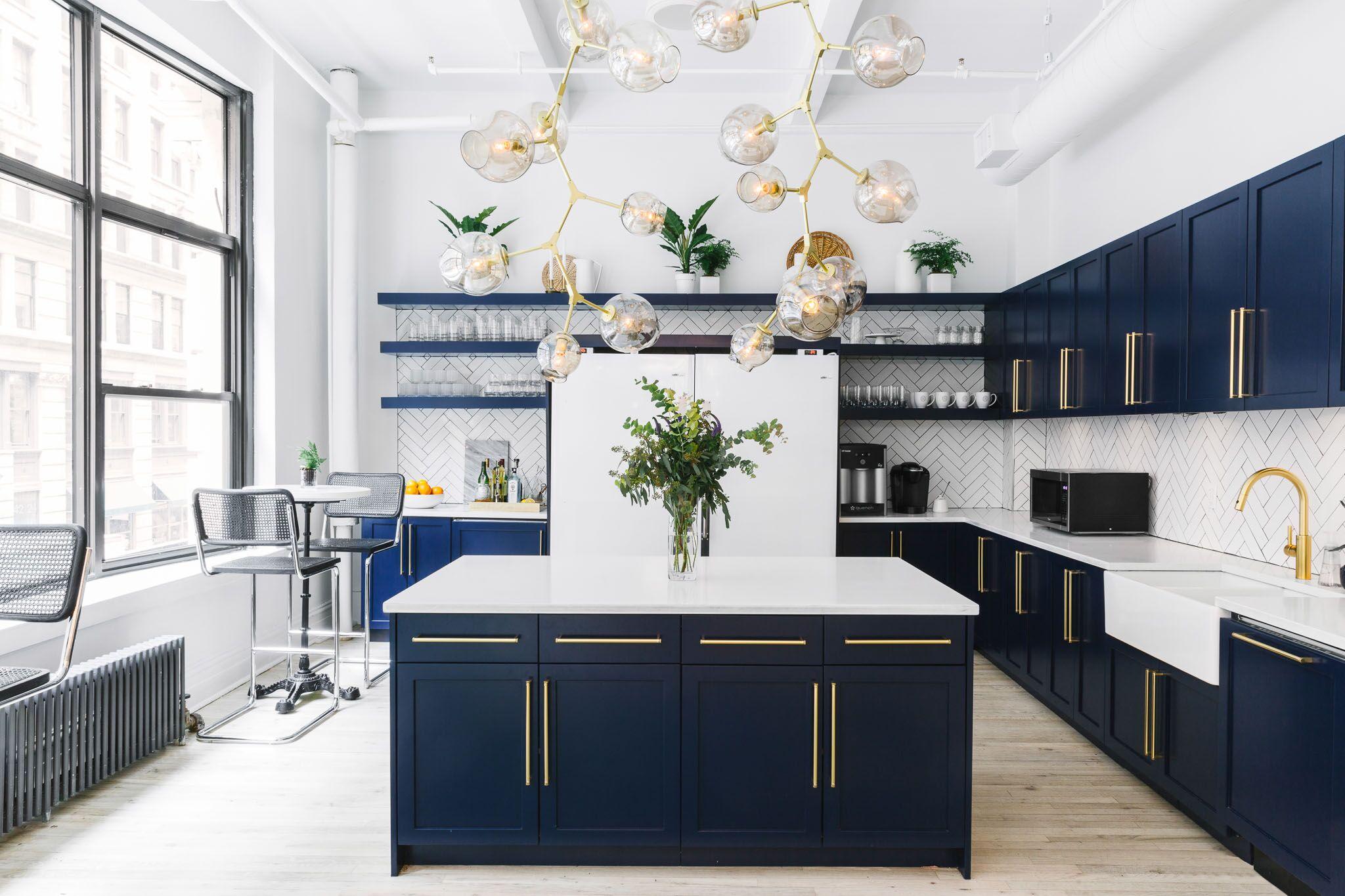 gold drawer pulls on dark kitchen cabinets