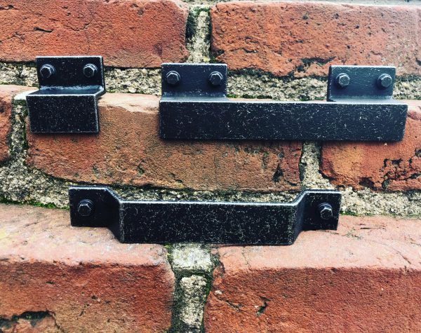 black industrial handles on red bricks