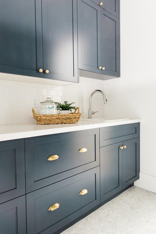 dark kitchen cabinets with gold cupboard handles