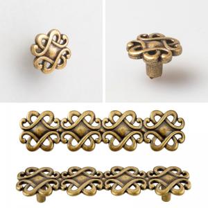 a set of vintage brass kitchen handles