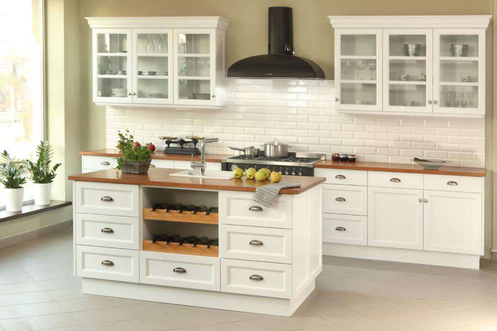 white bespoke kitchen with old steel cup handles