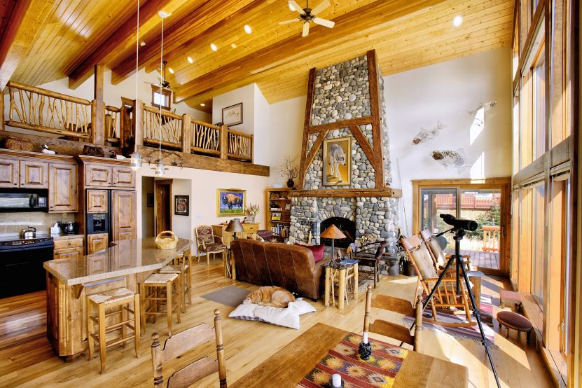 wood country kitchen with stoned fireplace